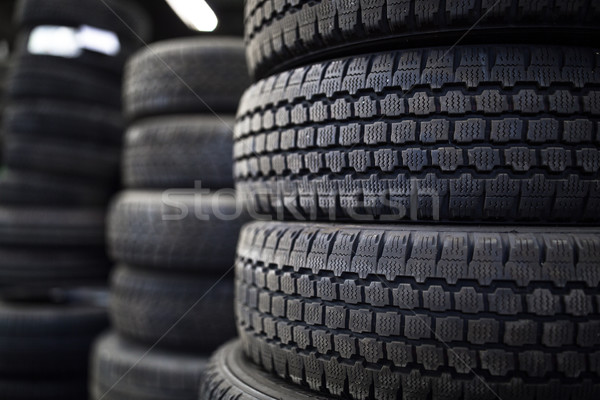 Tires for sale at a tire store - stacks of old used tires Stock photo © lightpoet