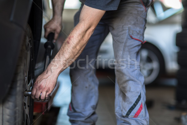 Wheel balancing or repair and change car tire at auto service Stock photo © lightpoet