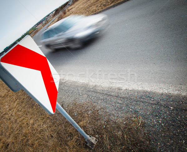 Stock photo: Traffic concept: car driving fast through a sharp turn (motion b