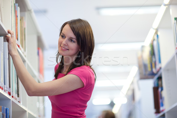 pretty young college student in an university library (shallow D Stock photo © lightpoet