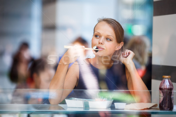 Pretty, young womna eating sushi in a restaurant Stock photo © lightpoet