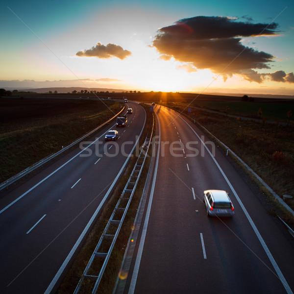 Autostrady ruchu ruchu zamazany ciężarówka zmierzch Zdjęcia stock © lightpoet