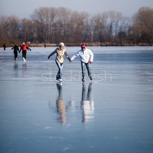 Couple ice skating outdoors on a pond  Stock photo © lightpoet