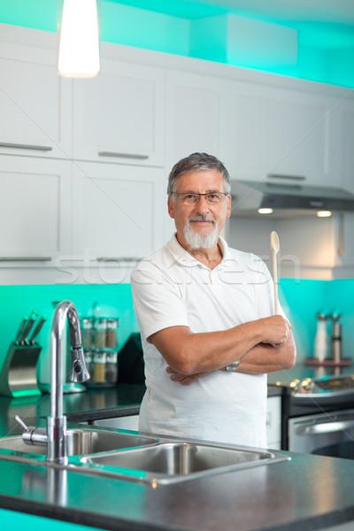 Senior man standing in his renovated, modern kitchen, Stock photo © lightpoet