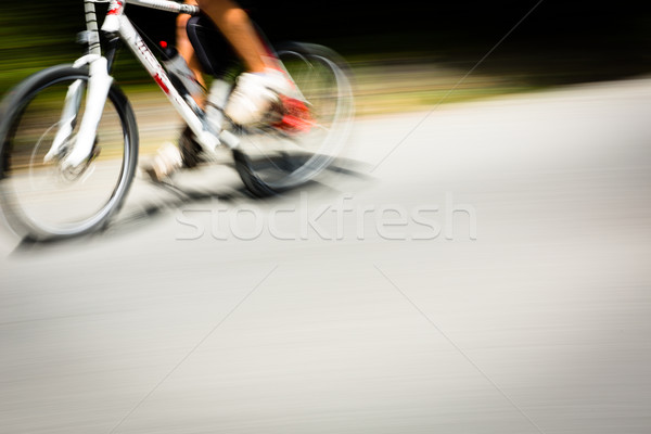 Cyclist on a road bike going fast (motion blur technique is used Stock photo © lightpoet