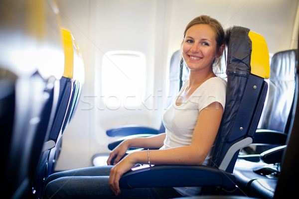 Pretty, young female passenger on board of an aircraft  Stock photo © lightpoet