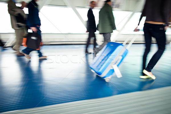 Personnes valises marche couloir aéroport Photo stock © lightpoet
