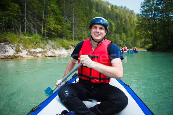 Rafting jonge man vlot boot man Stockfoto © lightpoet