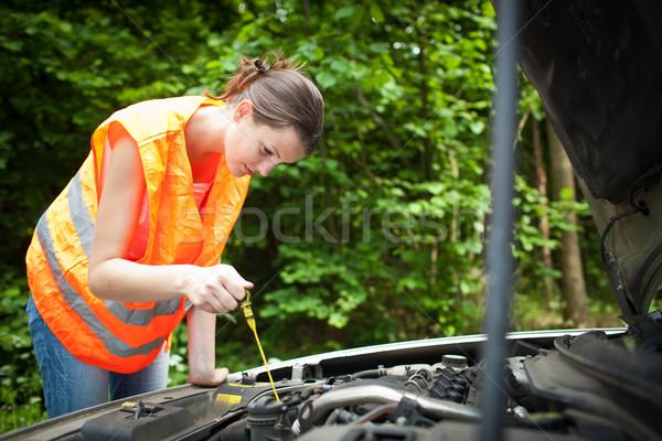 Stockfoto: Jonge · vrouwelijke · bestuurder · motor · gebroken