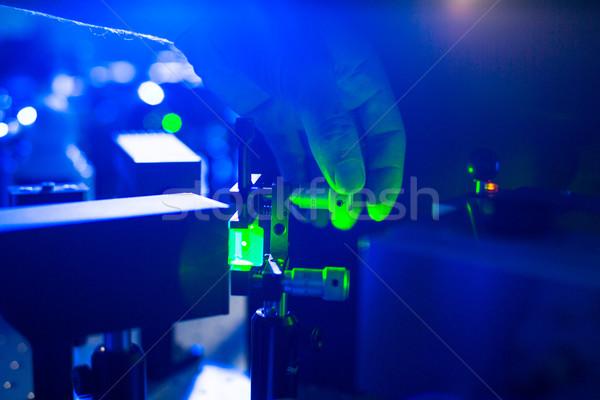 Quantum optics - hand of a researcher adjusting a laser beam Stock photo © lightpoet