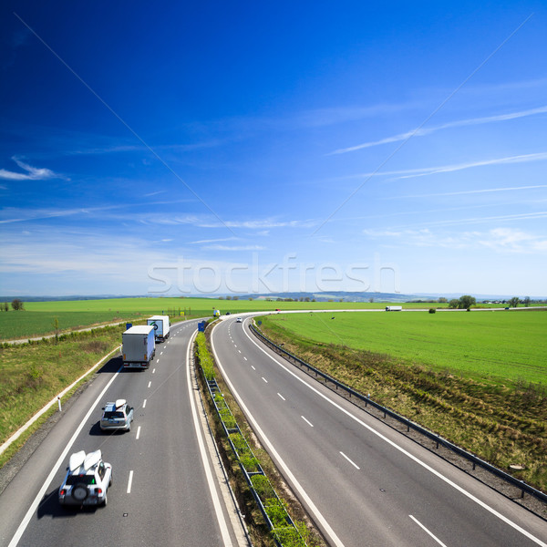 Stock photo: highway traffic on a lovely, sunny summer day
