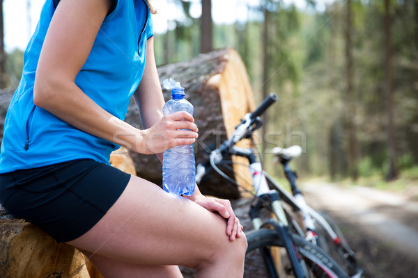 Pretty, young female biker outdoors on her mountain bike  Stock photo © lightpoet