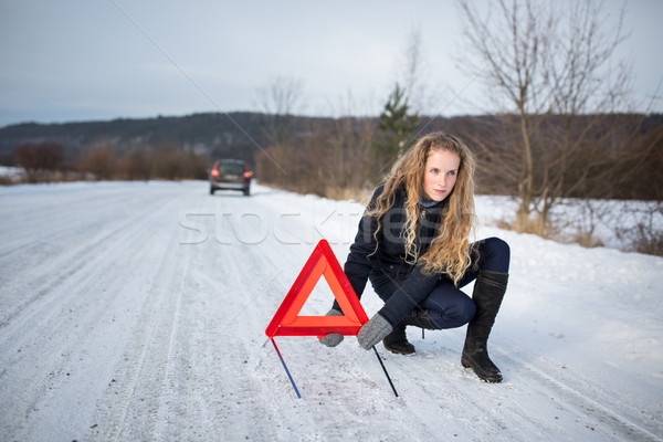 Young woman setting up a warning triangle and calling for assistance Stock photo © lightpoet