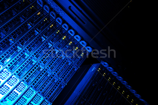 Server rack cluster in a data center (shallow DOF; color toned i Stock photo © lightpoet