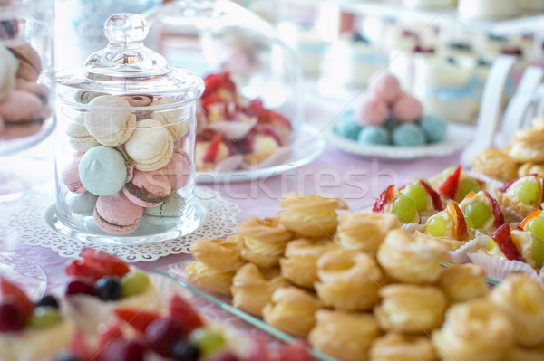 Table setting. Colorful macarons and cakes. Stock photo © lightpoet