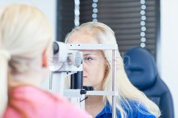 young female patient having her eyes examined  Stock photo © lightpoet