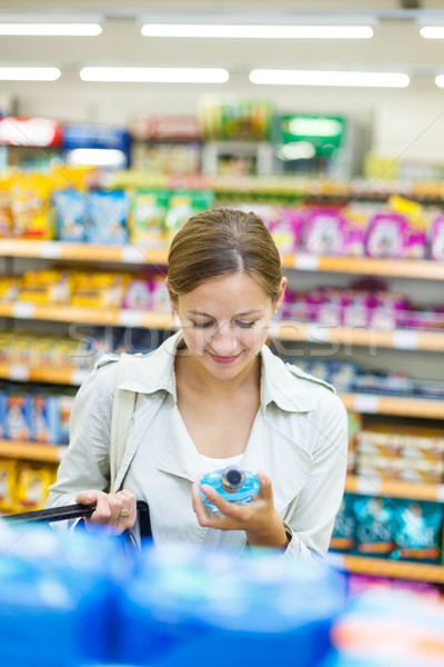 Stock photo: Beautiful young woman shopping in a grocery store/supermarket