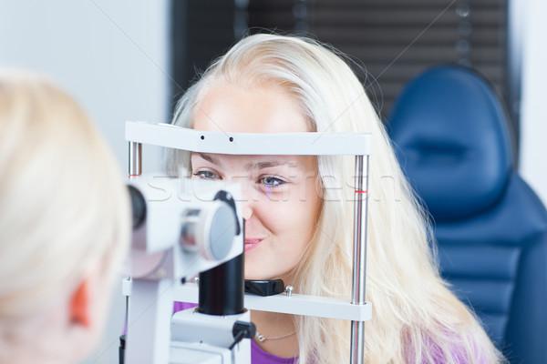 young female patient having her eyes examined  Stock photo © lightpoet