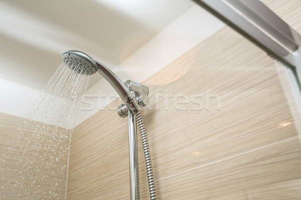 Shower head with dropping water Stock photo © lightpoet
