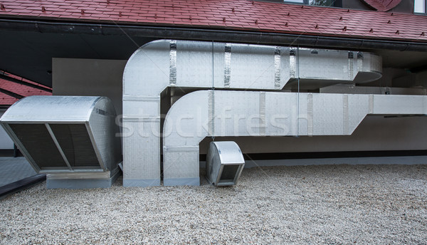 Air conditioning equipment atop a modern building  Stock photo © lightpoet
