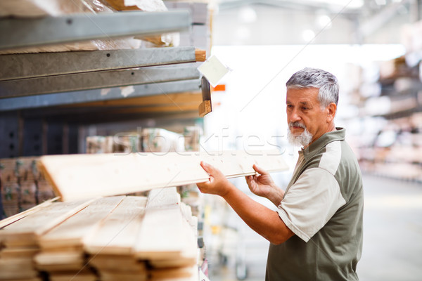 Senior man buying construction wood in a  DIY store Stock photo © lightpoet