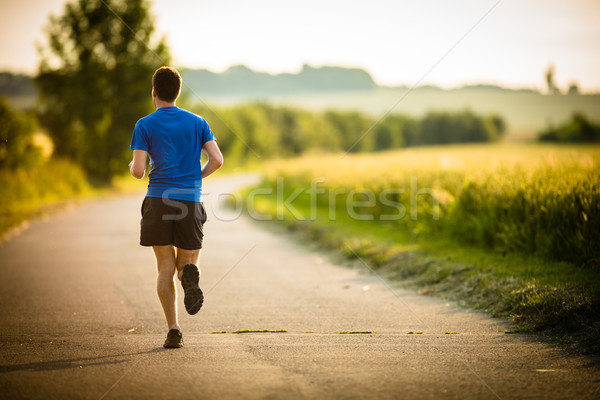 Male athlete/runner running on road - jog workout well-being con Stock photo © lightpoet