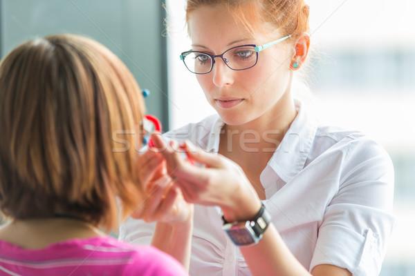 Optometry concept - pretty, young female optometrist Stock photo © lightpoet