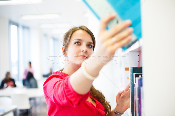 Pretty young college student in a library Stock photo © lightpoet