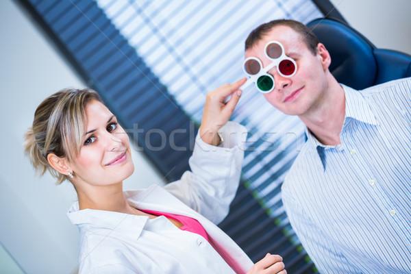 Fiatalember szemek szemorvos jóképű szín kép Stock fotó © lightpoet