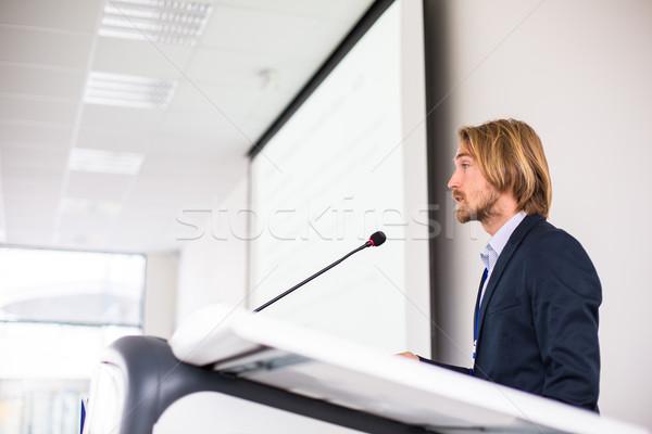 Yakışıklı genç konuşma konferans mikrofon konuşmacı Stok fotoğraf © lightpoet