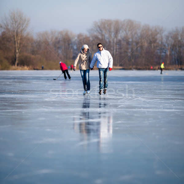 Couple ice skating outdoors on a pond  Stock photo © lightpoet
