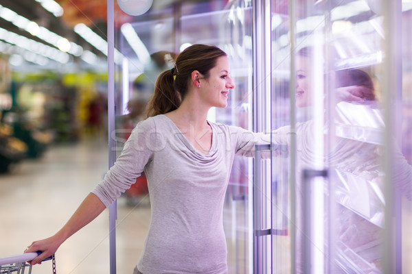 Young woman shopping for meat in a grocery store  Stock photo © lightpoet
