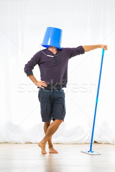 Young man mopping the floor. Or is he? Stock photo © lightpoet