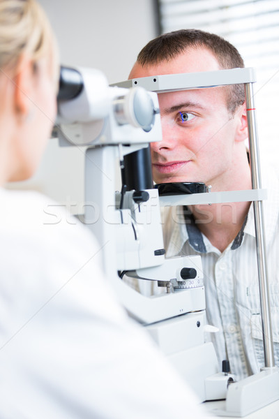 Knap jonge man ogen oogarts vrouw man Stockfoto © lightpoet