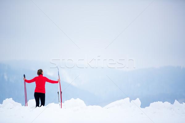 Cross-country skiing: young woman cross-country skiing Stock photo © lightpoet