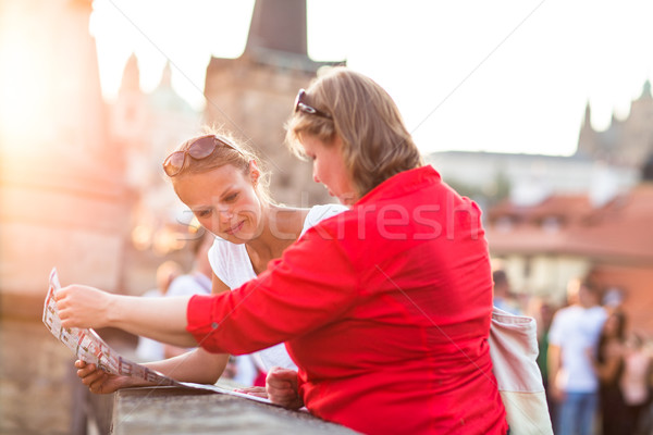 Mother and daughter traveling - two tourists studying a map Stock photo © lightpoet
