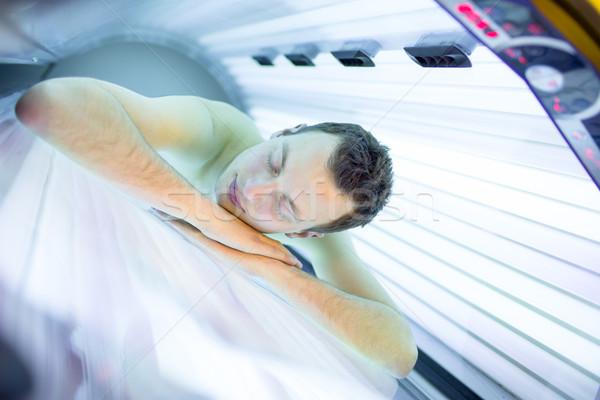 красивый молодым человеком расслабляющая солярий современных Сток-фото © lightpoet
