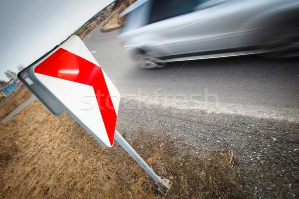 Traffic concept: car driving fast through a sharp turn (motion b Stock photo © lightpoet