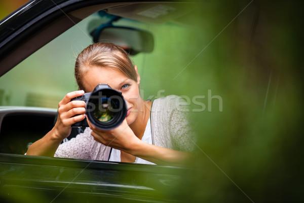 Female photographer/paparazzi taking pictures Stock photo © lightpoet