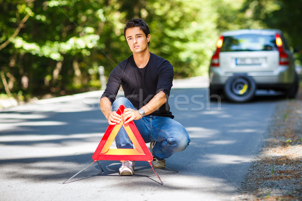 Handsome young man with his car broken down by the roadside Stock photo © lightpoet