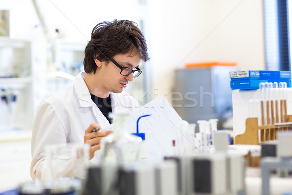 Male researcher carrying out scientific research in a lab (shall Stock photo © lightpoet