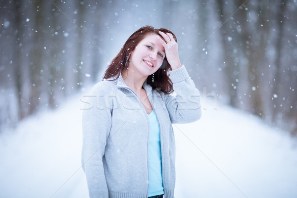Enjoying the first snow: young woman outdoors on a lovely forest Stock photo © lightpoet