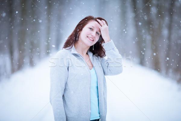 élvezi első hó fiatal nő kint erdő Stock fotó © lightpoet
