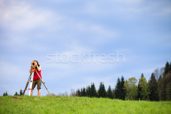 Young land surveyor at work Stock photo © lightpoet