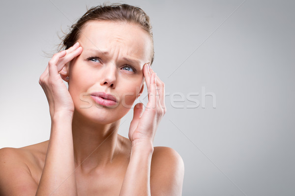 Gorgeous young woman with severe headache/migraine Stock photo © lightpoet