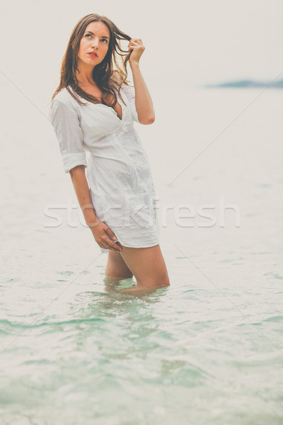 Woman relaxing at the beach with arms open enjoying her freedom, Stock photo © lightpoet