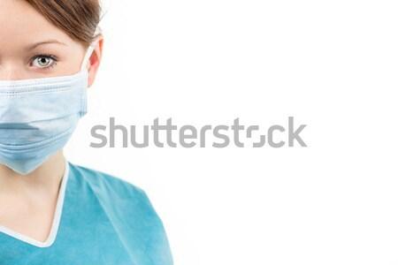 Portrait of a female doctor/surgeon on white background Stock photo © lightpoet