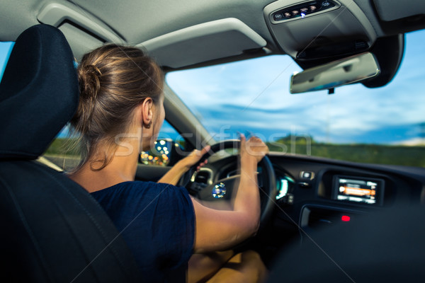 Young, woman driving a car at dusk Stock photo © lightpoet