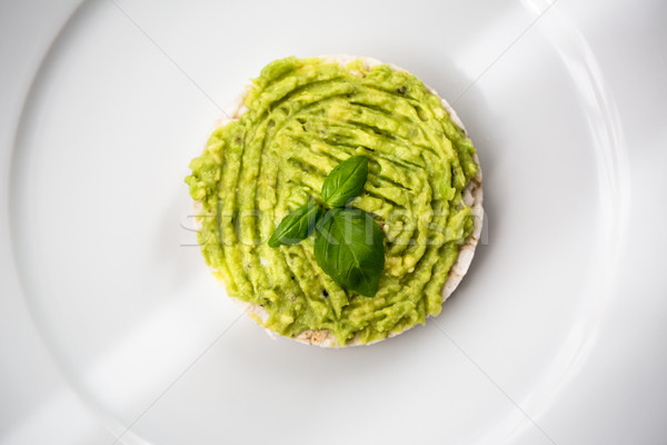Fresh avocado guacamole on rice bred with basil Stock photo © lightpoet