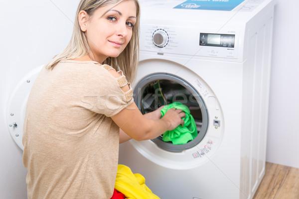 Housework: young woman doing laundry Stock photo © lightpoet